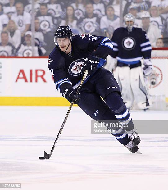 Tyler Myers of the Winnipeg Jets skates down the ice during second period action in Game Three of the Western Conference Quarterfinals against the...