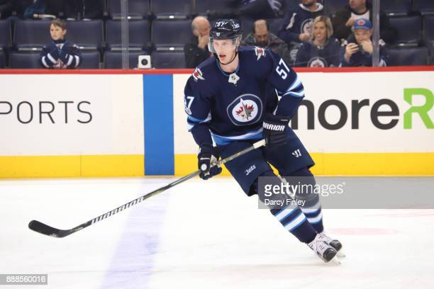 Tyler Myers of the Winnipeg Jets takes part in the pregame warm up prior to NHL action against the Ottawa Senators at the Bell MTS Place on December...