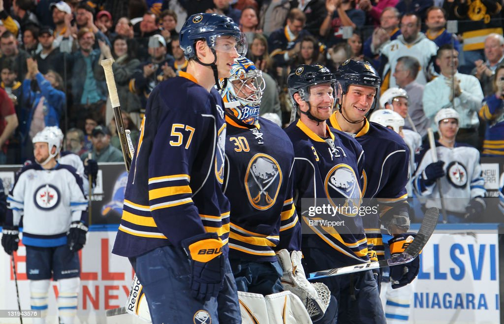 <a gi-track='captionPersonalityLinkClicked' href=/galleries/search?phrase=Tyler+Myers&family=editorial&specificpeople=4595080 ng-click='$event.stopPropagation()'>Tyler Myers</a> #57, Ryan Miller #30, <a gi-track='captionPersonalityLinkClicked' href=/galleries/search?phrase=Jordan+Leopold&family=editorial&specificpeople=201885 ng-click='$event.stopPropagation()'>Jordan Leopold</a> #3 and <a gi-track='captionPersonalityLinkClicked' href=/galleries/search?phrase=Cody+McCormick&family=editorial&specificpeople=213546 ng-click='$event.stopPropagation()'>Cody McCormick</a> #8 of the Buffalo Sabres are all smiles following their 6-5 overtime victory over the Winnipeg Jets at First Niagara Center on November 8, 2011 in Buffalo, New York.