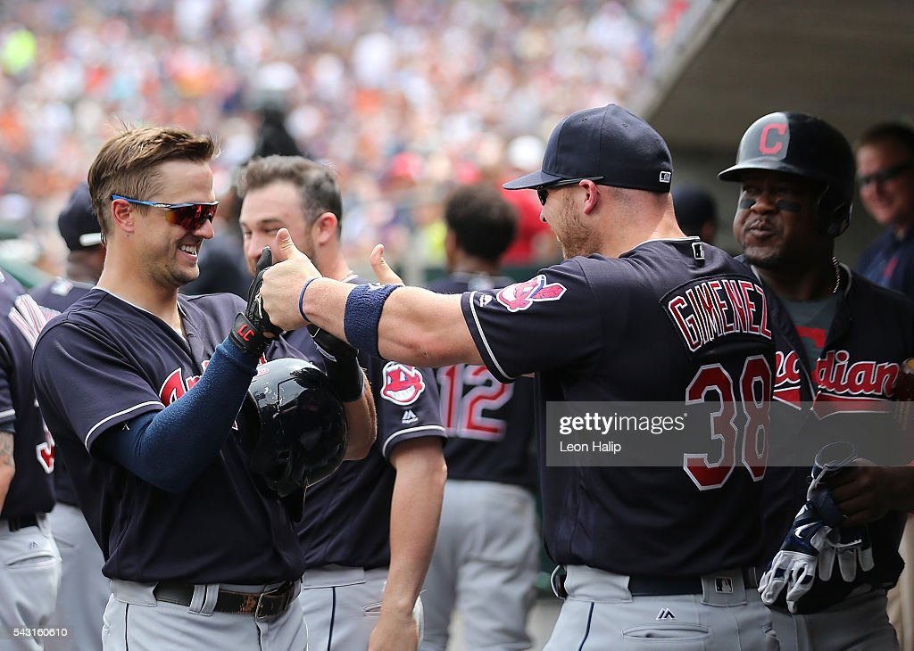 Tyler Naquin #30 and Chris Gimenez #38 of the Cleveland Indians celebrate in the dugout during a four home run inning against the Detroit Tigers on June 26, 2016 at Comerica Park in Detroit, Michigan.
