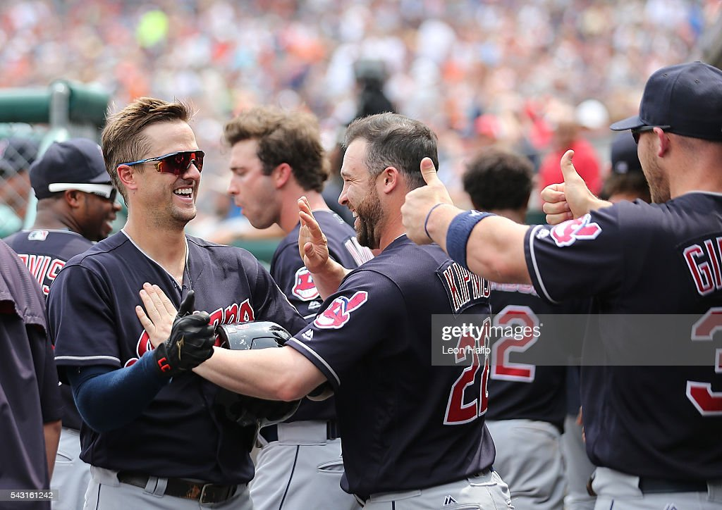 Tyler Naquin #30 and teammates <a gi-track='captionPersonalityLinkClicked' href=/galleries/search?phrase=Jason+Kipnis&family=editorial&specificpeople=5330784 ng-click='$event.stopPropagation()'>Jason Kipnis</a> #22 and <a gi-track='captionPersonalityLinkClicked' href=/galleries/search?phrase=Chris+Gimenez&family=editorial&specificpeople=4959066 ng-click='$event.stopPropagation()'>Chris Gimenez</a> #38 of the Cleveland Indians celebrate in the dugout during a four home run inning against the Detroit Tigers on June 26, 2016 at Comerica Park in Detroit, Michigan.