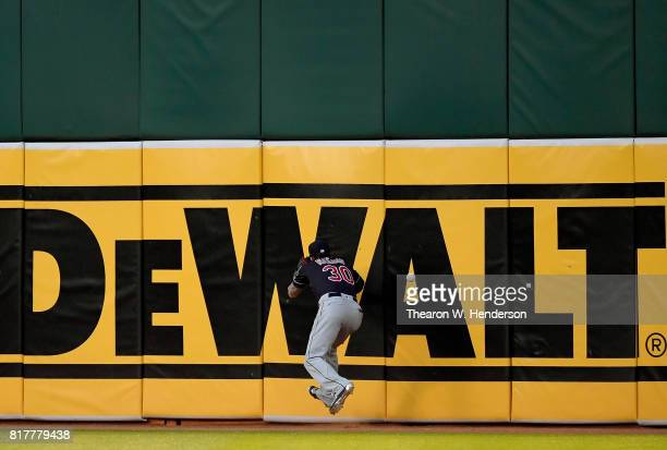 Tyler Naquin of the Cleveland Indians watches the ball go over his head and off the wall for a double off the bat of Bruce Maxwell of the Oakland...
