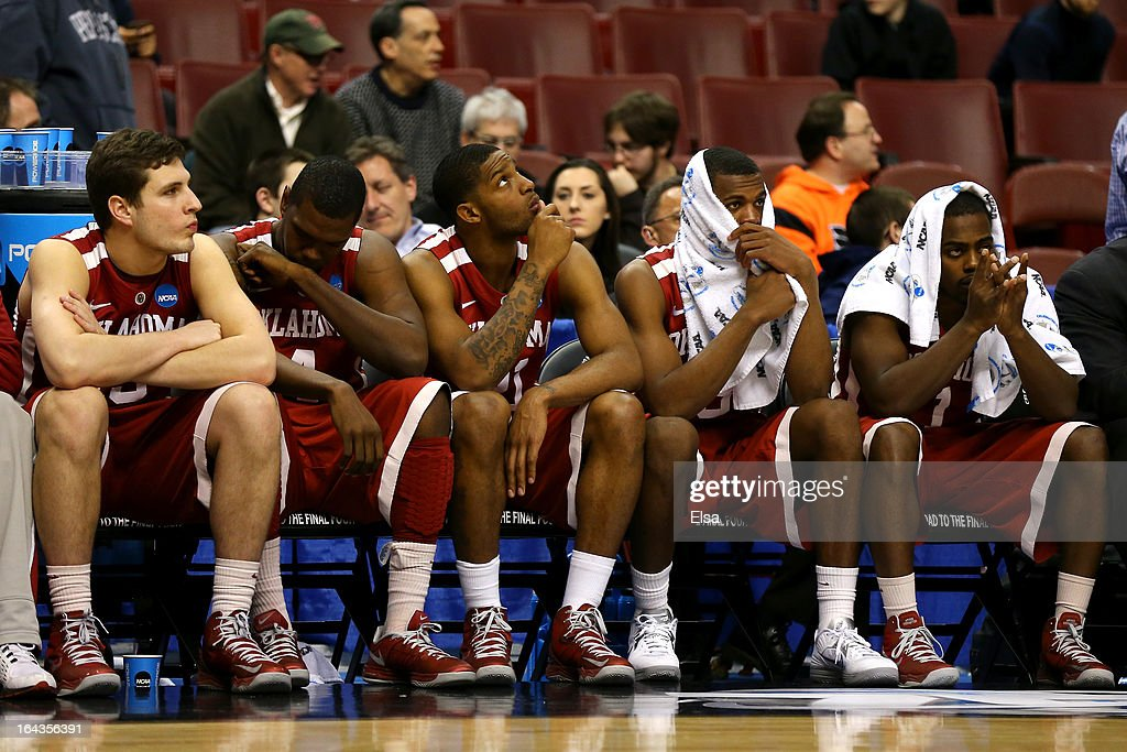 Tyler Neal #15, Andrew Fitzgerald #4, Cameron Clark #21, Buddy Hield #3 and Sam Grooms #1 of the Oklahoma Sooners sit on the bench dejected in the closing seconds against the San Diego State Aztecs during the second round of the 2013 NCAA Men's Basketball Tournament at Wells Fargo Center on March 22, 2013 in Philadelphia, Pennsylvania.
