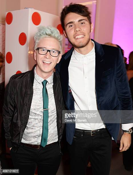 Tyler Oakley and Alfie Deyes attend YouTube phenomenon Zoe Sugg's launch of her debut beauty collection at 41 Portland Place on September 25 2014 in...