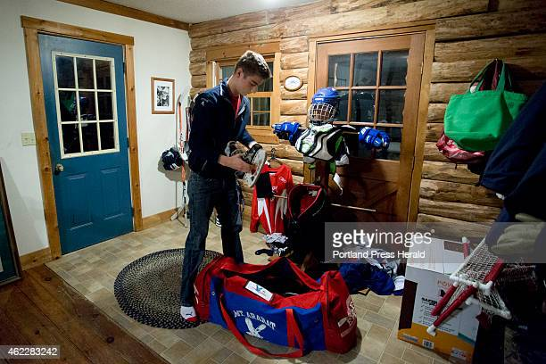 Tyler O'Connor of Bowdoinham packs his bag for hockey practice at 336 am Tuesday January 13 2015 Mt Ararat begins practice at 455 am at Watson Arena...
