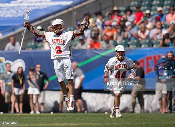 Tyler Pace and Sean Cannizzaro of the Denver Pioneers celebrate their win against the Maryland Terrapins on May 25 2015 in the NCAA Division I Men's...