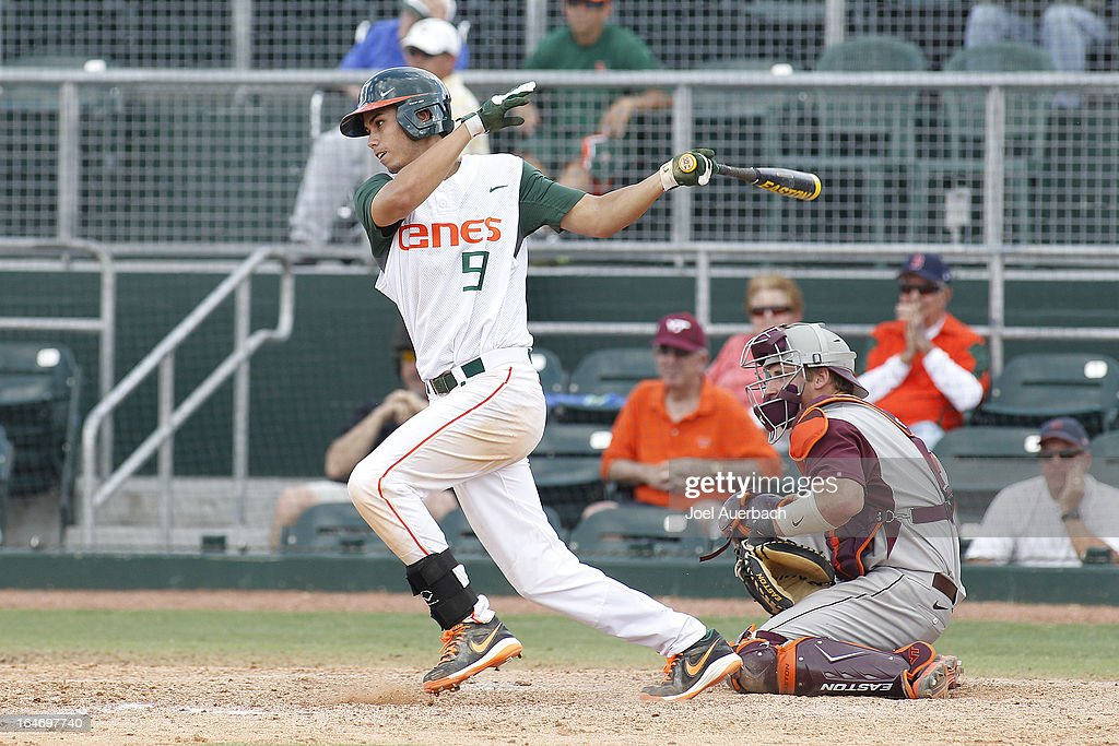 Tyler Palmer #9 of the Miami Hurricanes bats against the Virginia Tech Hokies in the bottom of the ninth inning on March 24, 2013 at Alex Rodriguez Park at Mark Light Field in Coral Gables, Florida. Virginia Tech defeated Miami 8-5 in 10 innings.