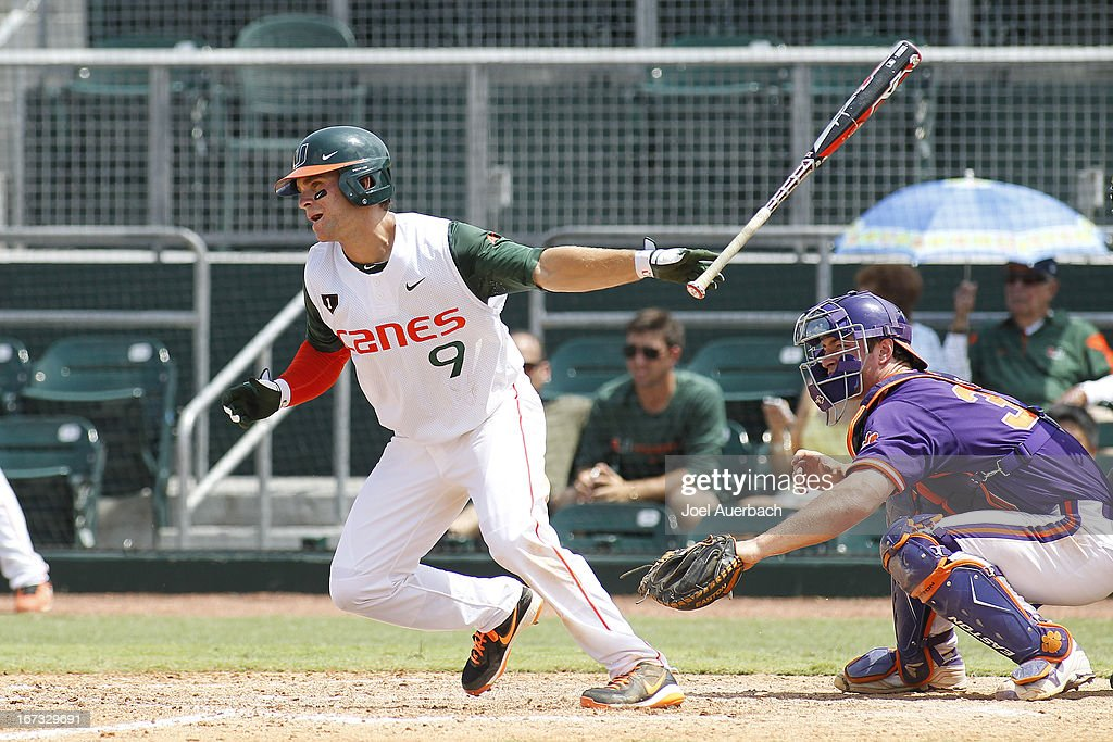 Tyler Palmer #9 of the Miami Hurricanes hits the ball against the Clemson Tigers on April 21, 2013 at Alex Rodriguez Park at Mark Light Field in Coral Gables, Florida. Miami defeated Clemson 7-0.