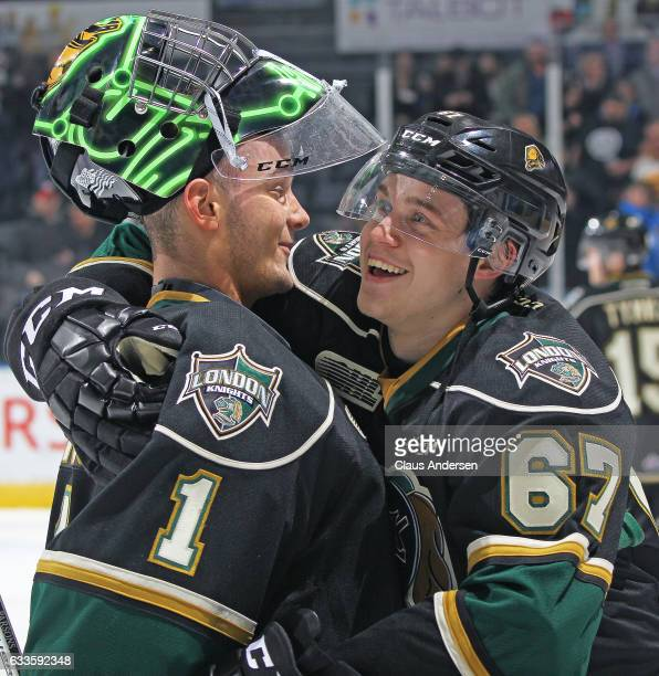Tyler Parsons and Mitchell Stephens of the London Knights celebrate a victory against the Kitchener Rangers in an OHL game at Budweiser Gardens on...