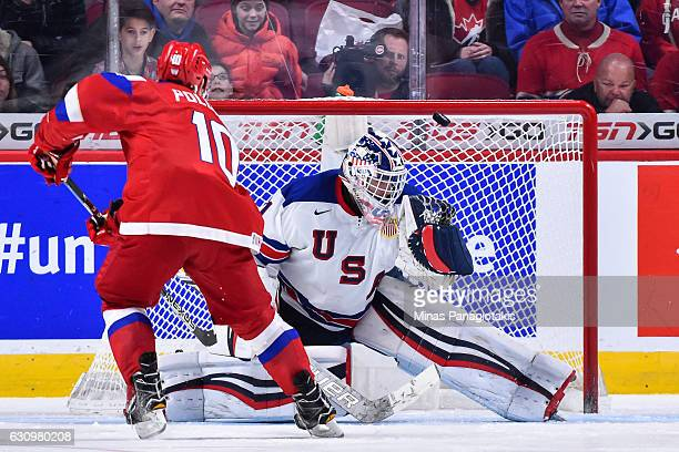 Tyler Parsons of Team United States makes a save on Alexander Polunin of Team Russia during the 2017 IIHF World Junior Championship semifinal game at...