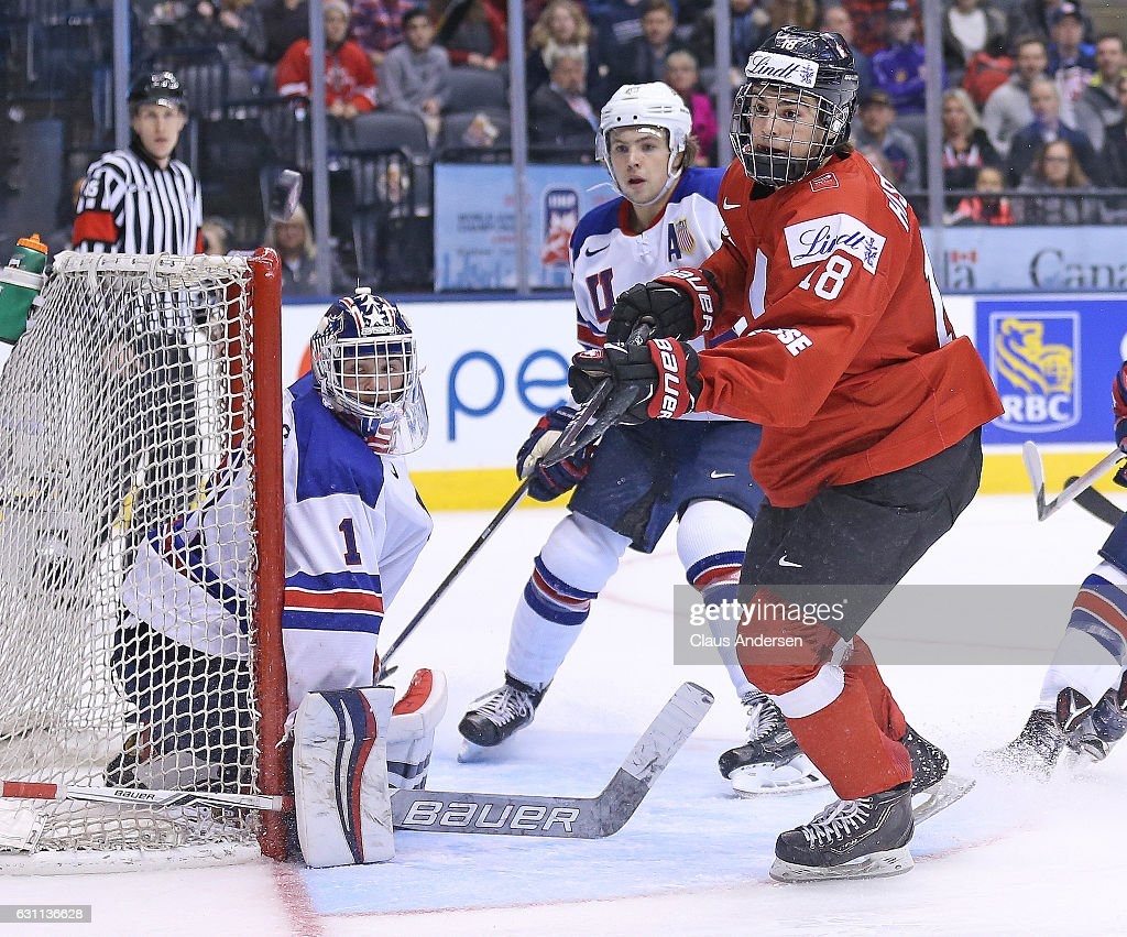 Tyler Parsons #1 of Team USA guards the corner against Nico Hischier #18 of Team Switzerland during a QuarterFinal game at the 2017 IIHF World Junior Hockey Championships at Air Canada Centre on January 2, 2017 in Toronto, Ontario, Canada. Team USA defeated Team Switzerland 3-2.
