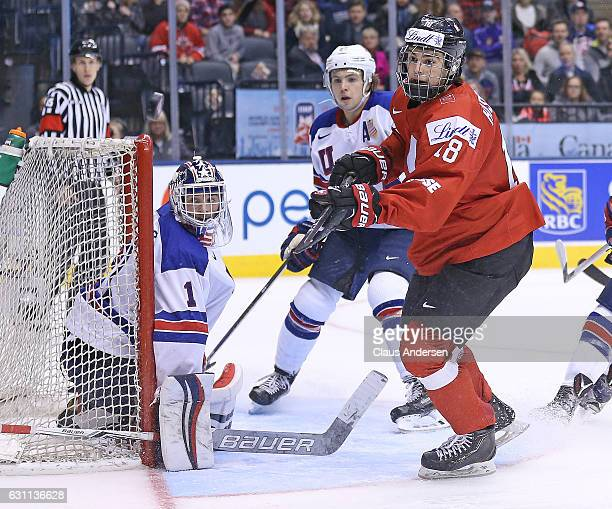 Tyler Parsons of Team USA guards the corner against Nico Hischier of Team Switzerland during a QuarterFinal game at the 2017 IIHF World Junior Hockey...