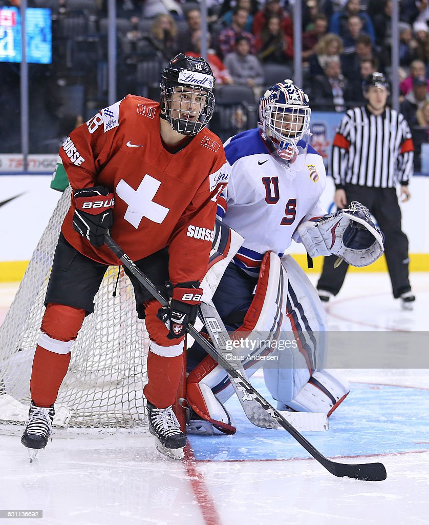 Tyler Parsons #1 of Team USA protects the corner with Nico Hischier #18 of Team Switzerland on his doorstep during a QuarterFinal game at the 2017 IIHF World Junior Hockey Championships at Air Canada Centre on January 2, 2017 in Toronto, Ontario, Canada. Team USA defeated Team Switzerland 3-2.