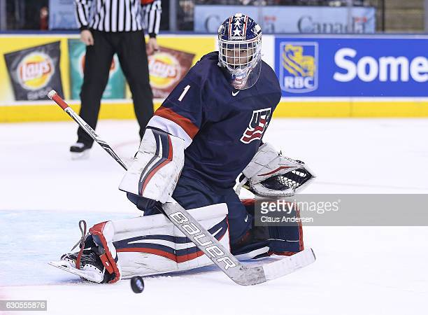 Tyler Parsons of Team USA turns a shot away against Team Latvia during a 2017 IIHF World Junior Hockey Championship game at the Air Canada Centre on...