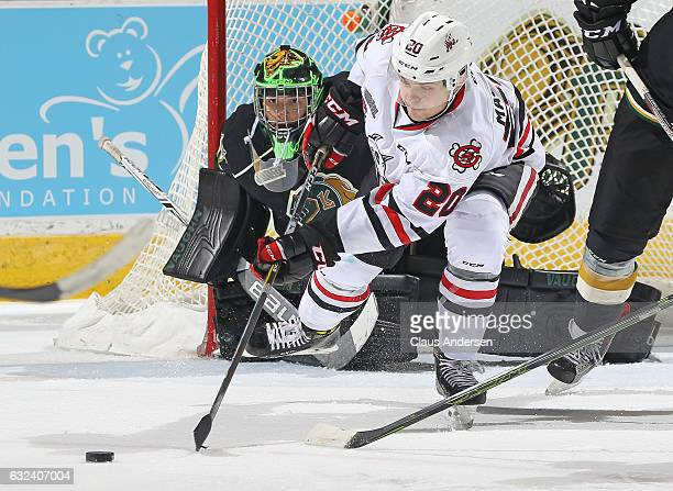 Tyler Parsons of the London Knights keeps a close eye on Ondrej Machala of the Niagara IceDogs during an OHL game at Budweiser Gardens on January 22...