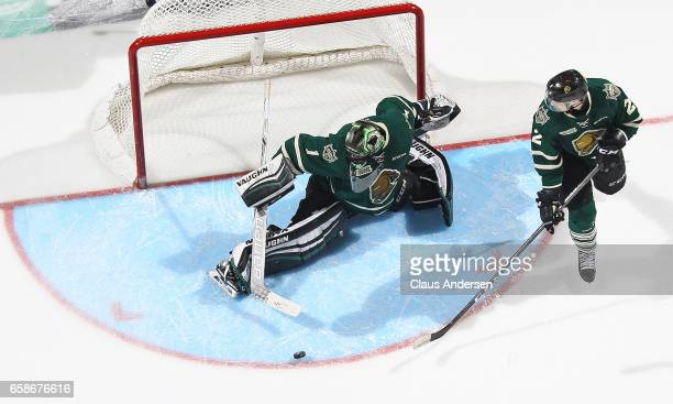 Tyler Parsons of the London Knights kicks out a shot against the Windsor Spitfires during Game Two of the OHL Western Conference Quarter Finals at...