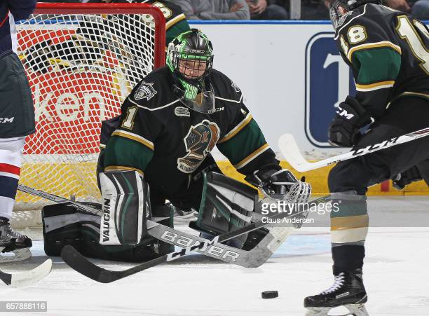 Tyler Parsons of the London Knights looks to stop a rebound against the Windsor Spitfires during Game One of the OHL Western Conference Quarter...