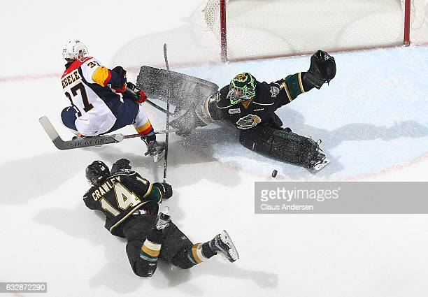 Tyler Parsons of the London Knights makes a stop on Warren Foegele of the Erie Otters during an OHL game at Budweiser Gardens on January 27 2017 in...