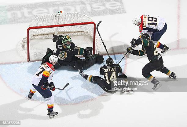 Tyler Parsons of the London Knights slides accross to stop Dylan Strome of the Erie Otters during an OHL game at Budweiser Gardens on January 27 2017...