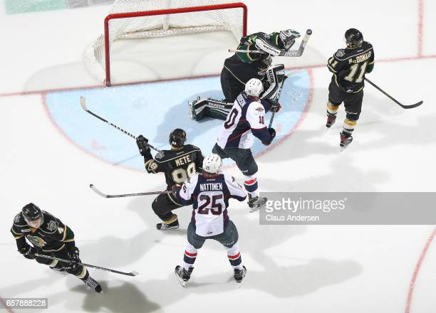 Tyler Parsons of the London Knights stops a high shot against the Windsor Spitfires during Game One of the OHL Western Conference Quarter Finals at...