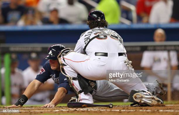 Tyler Pastornicky of the Atlanta Braves is tagged out at home by Jarrod Saltalamacchia of the Miami Marlins during a game at Marlins Park on April 29...