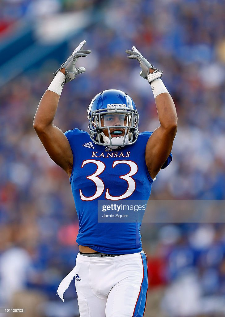 Tyler Patmon #33 of the Kansas Jayhawks encourages the crowd during the game against the South Dakota State Jackrabbits at Memorial Stadium on September 1, 2012 in Lawrence, Kansas.