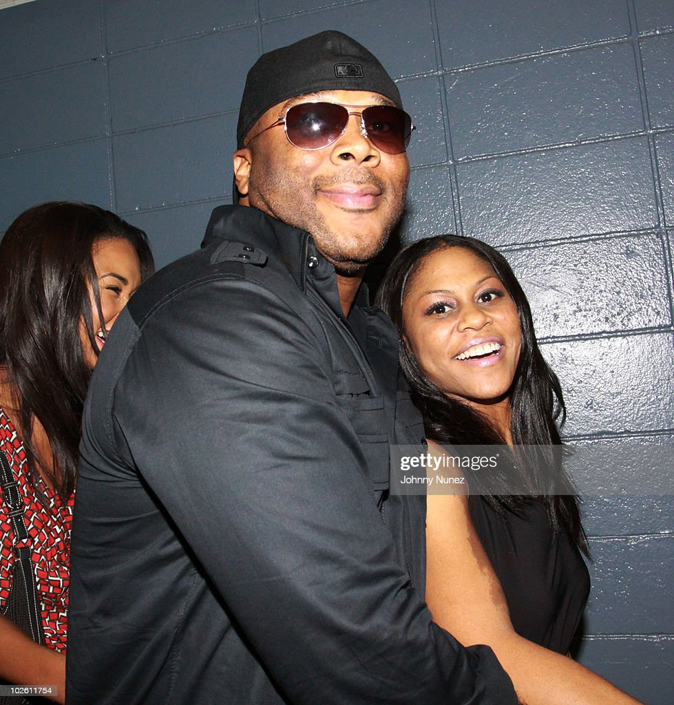 Tyler Perry and guest attend the 2010 Essence Music Festival at the Louisiana Superdome on July 2 2010 in New Orleans Louisiana
