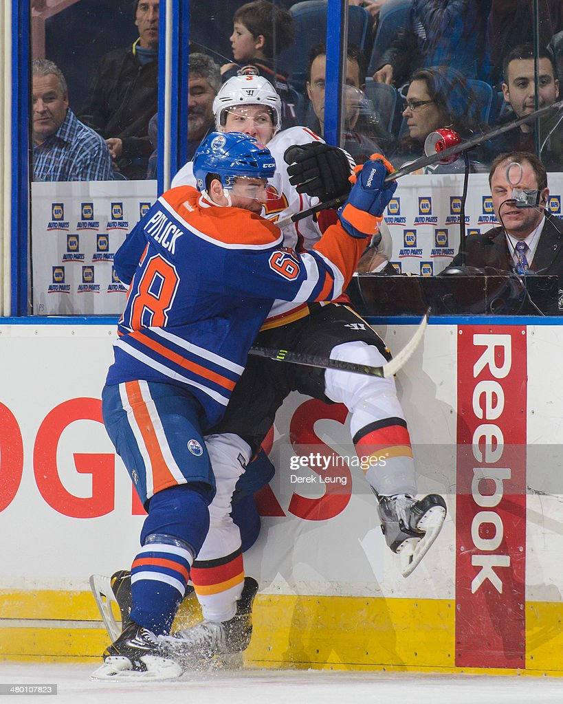 <a gi-track='captionPersonalityLinkClicked' href=/galleries/search?phrase=Tyler+Pitlick&family=editorial&specificpeople=7029355 ng-click='$event.stopPropagation()'>Tyler Pitlick</a> #68 of the Edmonton Oilers checks Ladislav Smid #3 of the Calgary Flames during an NHL game at Rexall Place on March 22, 2014 in Edmonton, Alberta, Canada. The Flames defeated the Oilers 8-1.