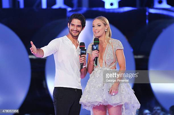 Tyler Posey and Liz Trinnear present at the 2015 Much Music Video Awards at MuchMusic HQ on June 21 2015 in Toronto Canada