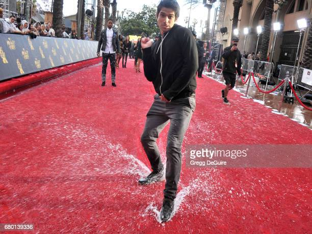 Tyler Posey arrives at the 2017 MTV Movie And TV Awards at The Shrine Auditorium on May 7 2017 in Los Angeles California