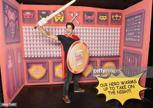 Tyler Posey poses in the Nissin Cup Noodles Lair at the annual Heroes After Dark celebration at Highline Ballroom on October 6 2017 in New York City...
