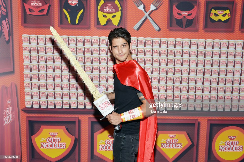 Tyler Posey poses in the Nissin Cup Noodles Lair at the annual Heroes After Dark celebration at Highline Ballroom on October 6, 2017 in New York City. Nissin Cup Noodles invited 20 lucky fans to unleash their inner superhero at the brand's Noods Before Dark pre-party during New York Comic Con, alongside Cup Noodles enthusiast, Tyler Posey. At the exclusive pre-party for the annual Heroes After Dark celebration, Posey and VIP guests posed for an action shot in the Nissin Cup Noodles Lair with a one-of-a-kind Cup Noodles sword after they slurped on hot cups of the instant noodles.