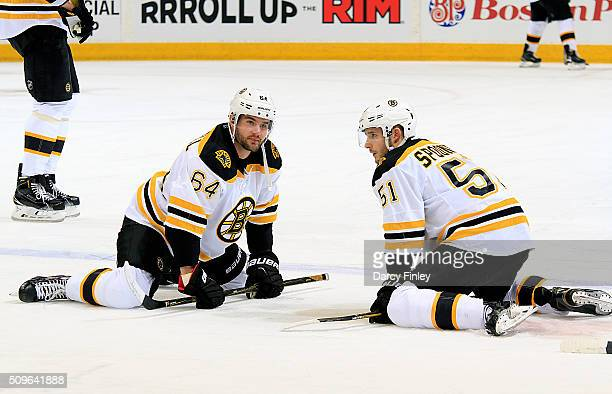 Tyler Randell and Ryan Spooner of the Boston Bruins take part in the pregame warm up prior to NHL action against the Winnipeg Jets at the MTS Centre...