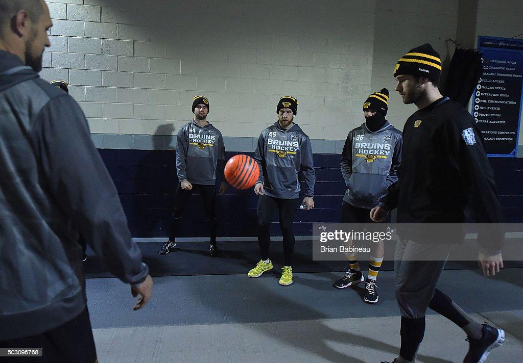 Tyler Randell Joe Morrow Zac Rinaldo of the Boston Bruins and their teammates warm up in the hallway prior to the 2016 Bridgestone NHL Classic at...