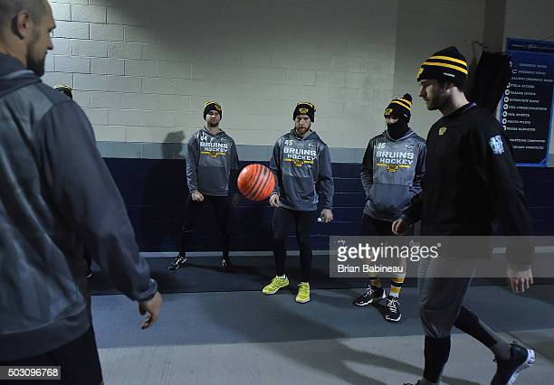 Tyler Randell Joe Morrow Zac Rinaldo of the Boston Bruins and their teammates warm up in the hallway prior to the 2016 Bridgestone NHL Classic at...