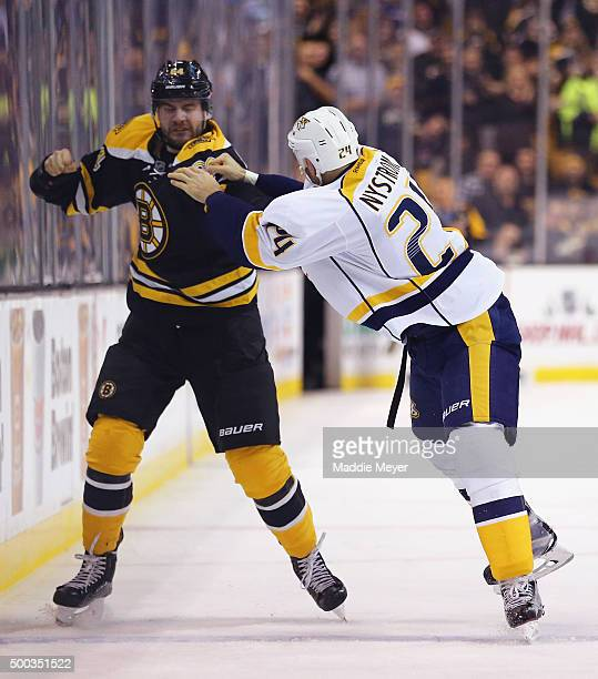 Tyler Randell of the Boston Bruins and Eric Nystrom of the Nashville Predators fight during the second period at TD Garden on December 7 2015 in...