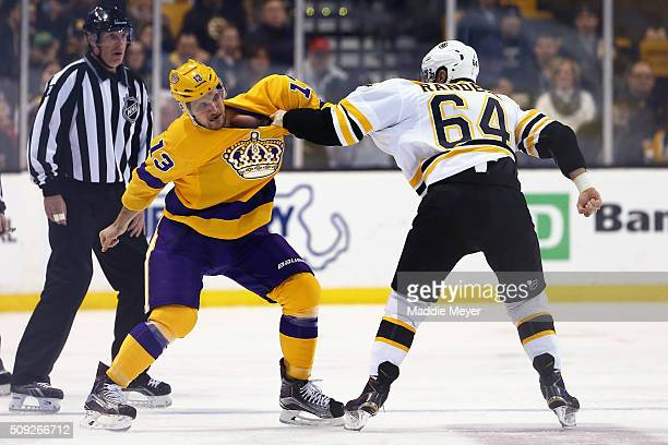 Tyler Randell of the Boston Bruins and Kyle Clifford of the Los Angeles Kings fight during the first period at TD Garden on February 9 2016 in Boston...