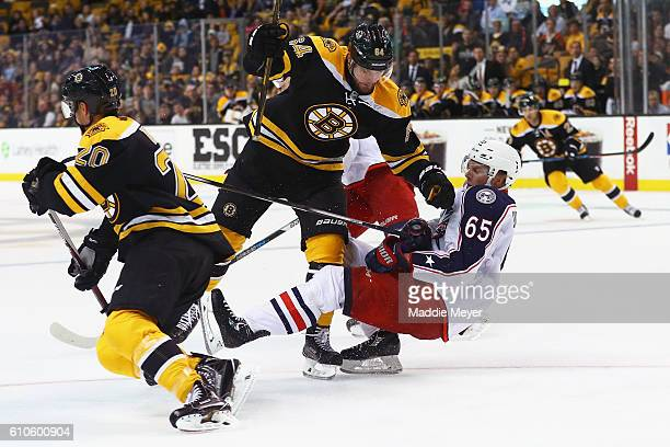 Tyler Randell of the Boston Bruins decks Markus Nutivaara of the Columbus Blue Jackets during overtime of their preseason game at TD Garden on...
