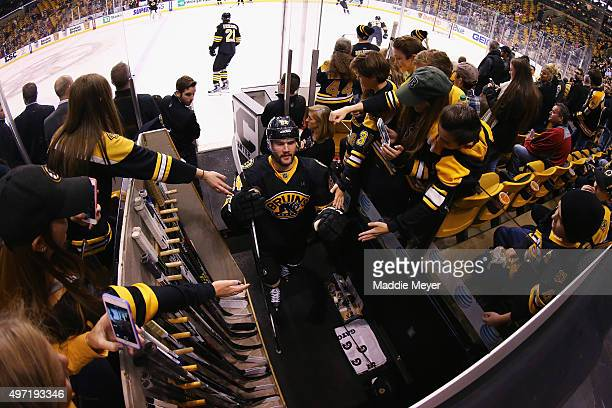Tyler Randell of the Boston Bruins exits the ice after warm ups before the game against the Detroit Red Wings during the first period at TD Garden on...