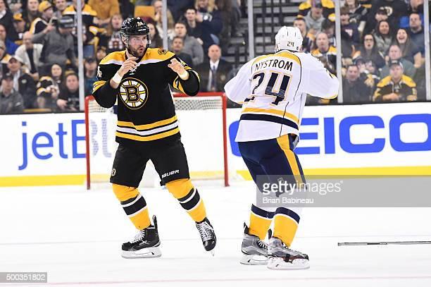 Tyler Randell of the Boston Bruins fights Eric Nystrom of the Nashville Predators at the TD Garden on December 7 2015 in Boston Massachusetts