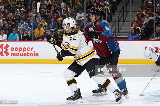 Tyler Randell of the Boston Bruins skates against Erik Johnson of the Colorado Avalanche at Pepsi Center on October 14 2015 in Denver Colorado The...