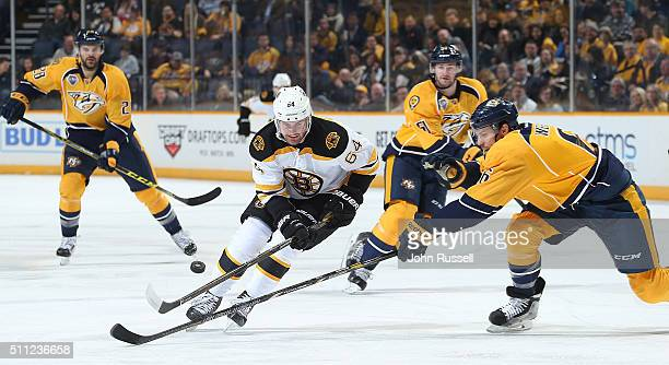 Tyler Randell of the Boston Bruins skates the puck in the zone against Shea Weber of the Nashville Predators during an NHL game at Bridgestone Arena...