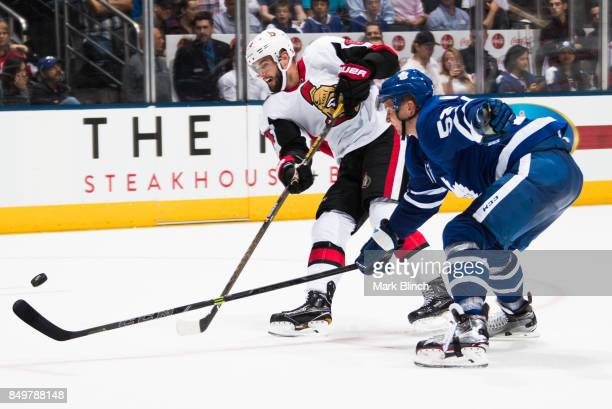 Tyler Randell of the Ottawa Senators shoots past Martin Marincin of the Toronto Maple Leafs during the second period at the Air Canada Centre in...