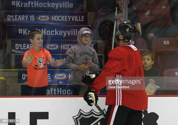 Tyler Randell of the Ottawa Senators tosses a puck to fans during Kraft Hockeyville Canada on September 25 2017 at Credit Union Place in Summerside...