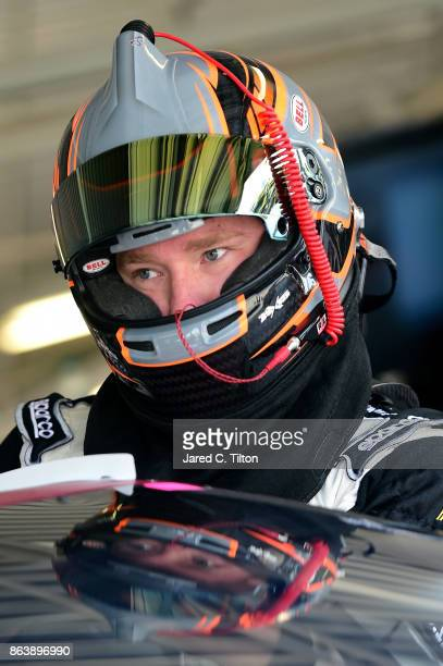 Tyler Reddick driver of the BBR/Dustin Lynch Chevrolet climbs into his car during practice for the NASCAR XFINITY Series Kansas Lottery 300 at Kansas...