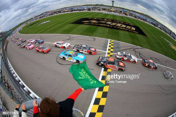 Tyler Reddick driver of the BBR/Dustin Lynch Chevrolet leads the field to the green flag to start the NASCAR XFINITY Series Kansas Lottery 300 at...
