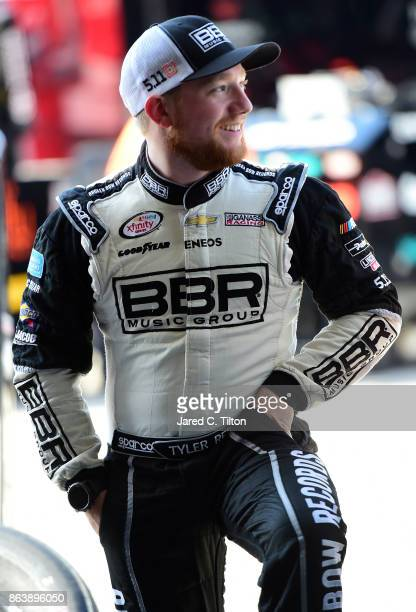 Tyler Reddick driver of the BBR/Dustin Lynch Chevrolet stands in the garage during practice for the NASCAR XFINITY Series Kansas Lottery 300 at...
