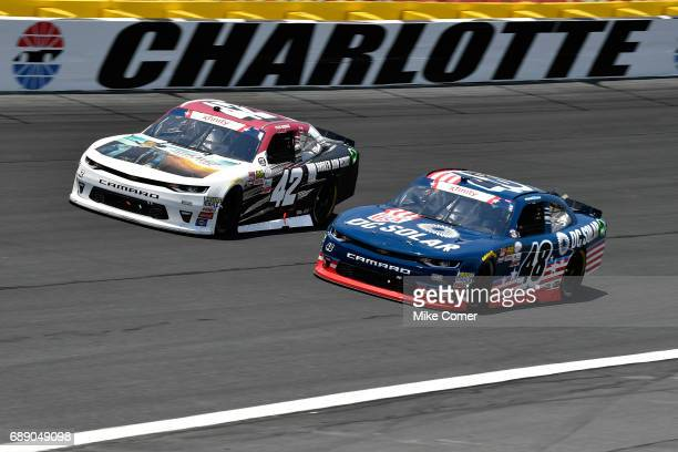 Tyler Reddick driver of the BBR/Jason Aldean Chevrolet races Brennan Poole driver of the DC Solar Chevrolet during the NASCAR Xfinity Series Hisense...