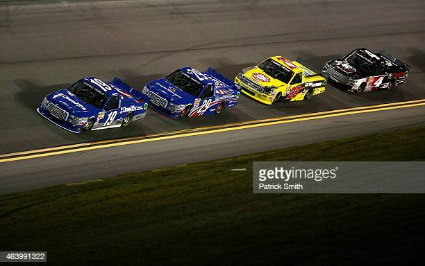 Tyler Reddick driver of the DrawTite Ford leads a pack of trucks during the NASCAR Camping World Truck Series NextEra Energy Resources 250 at Daytona...