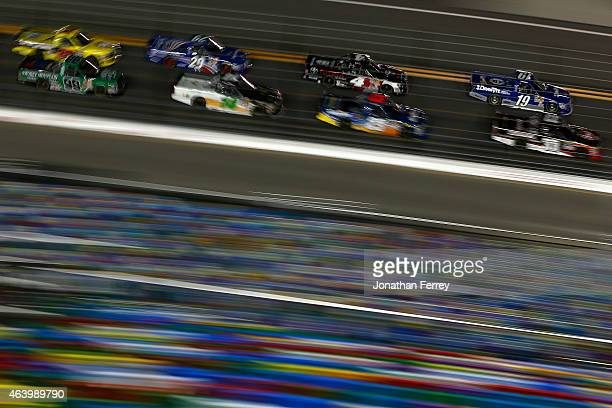 Tyler Reddick driver of the DrawTite Ford races at the head of a pack of trucks during the NASCAR Camping World Truck Series NextEra Energy Resources...